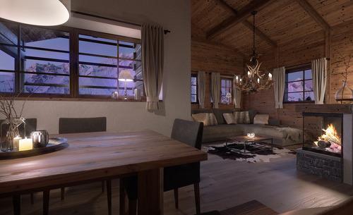 Der offene Wohn- und Essbereich mit Kamin sorgt für ein gemütliches Ambiente während Ihrem Familienurlaub im Chalet